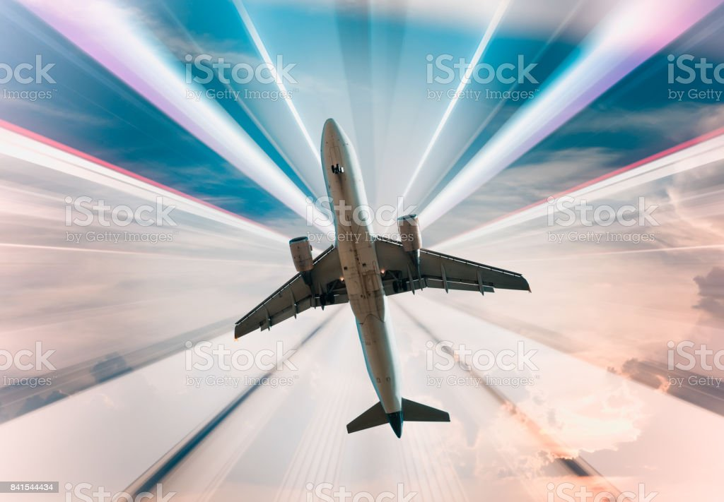 Airplane on divergent rays background stock photo