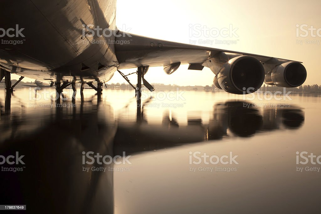 Airplane on flood water at airport royalty-free stock photo