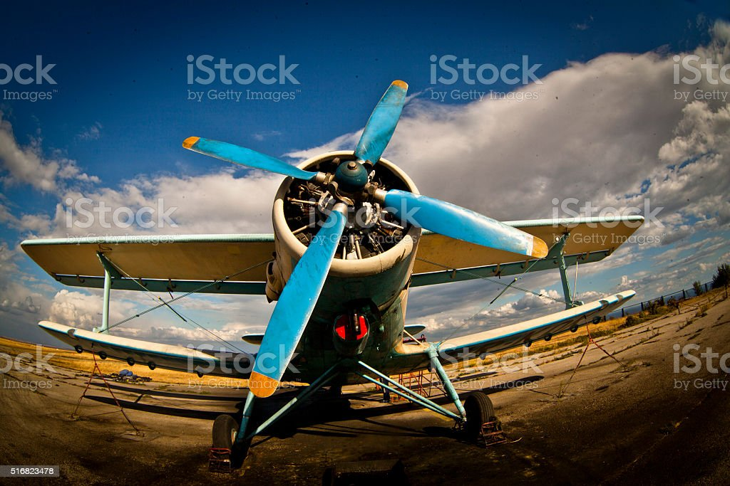 airplane on green grass stock photo