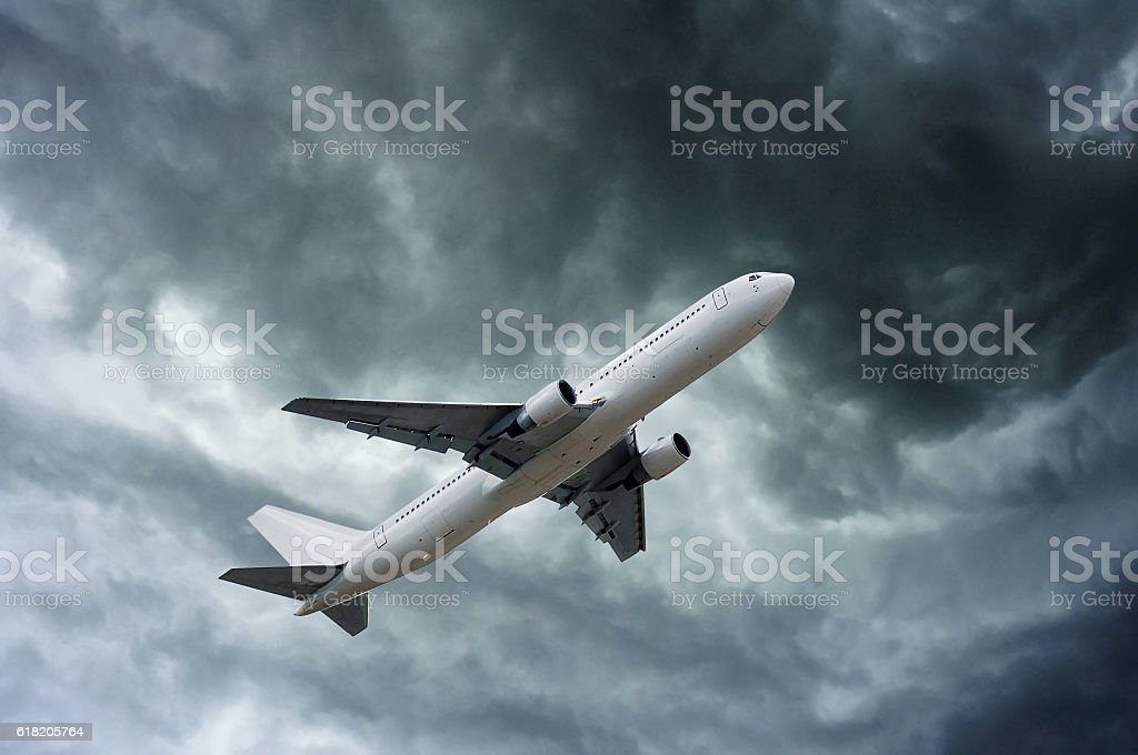 airplane on impressive gray cloud before rain stock photo