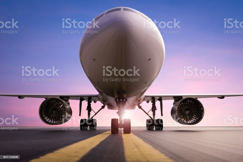 airplane on runway stock photo