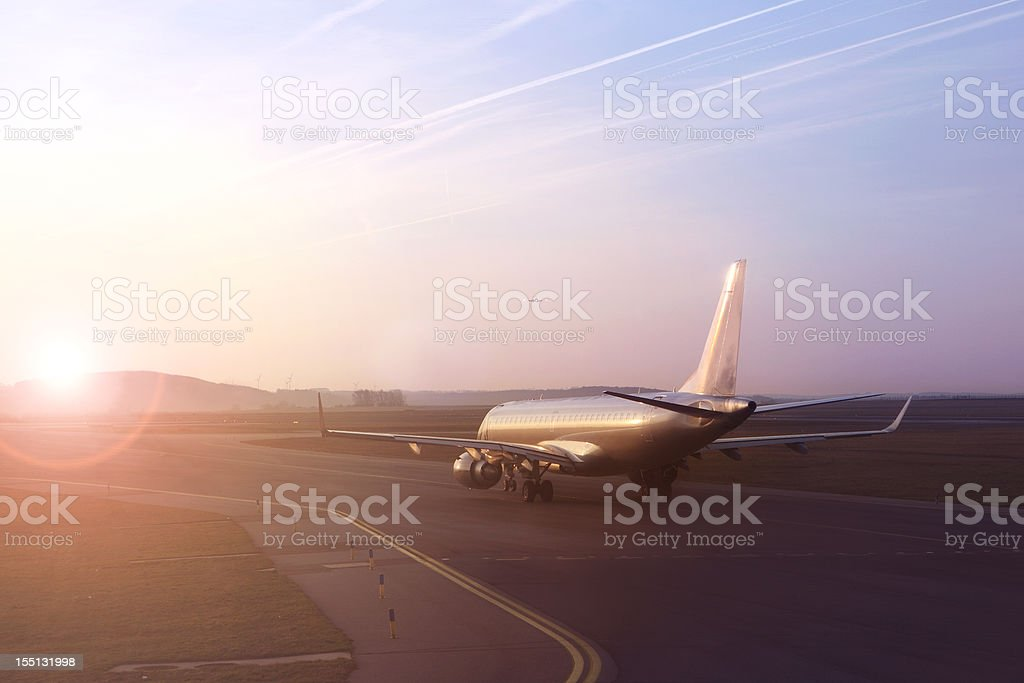 Airplane on runway ready to take off stock photo
