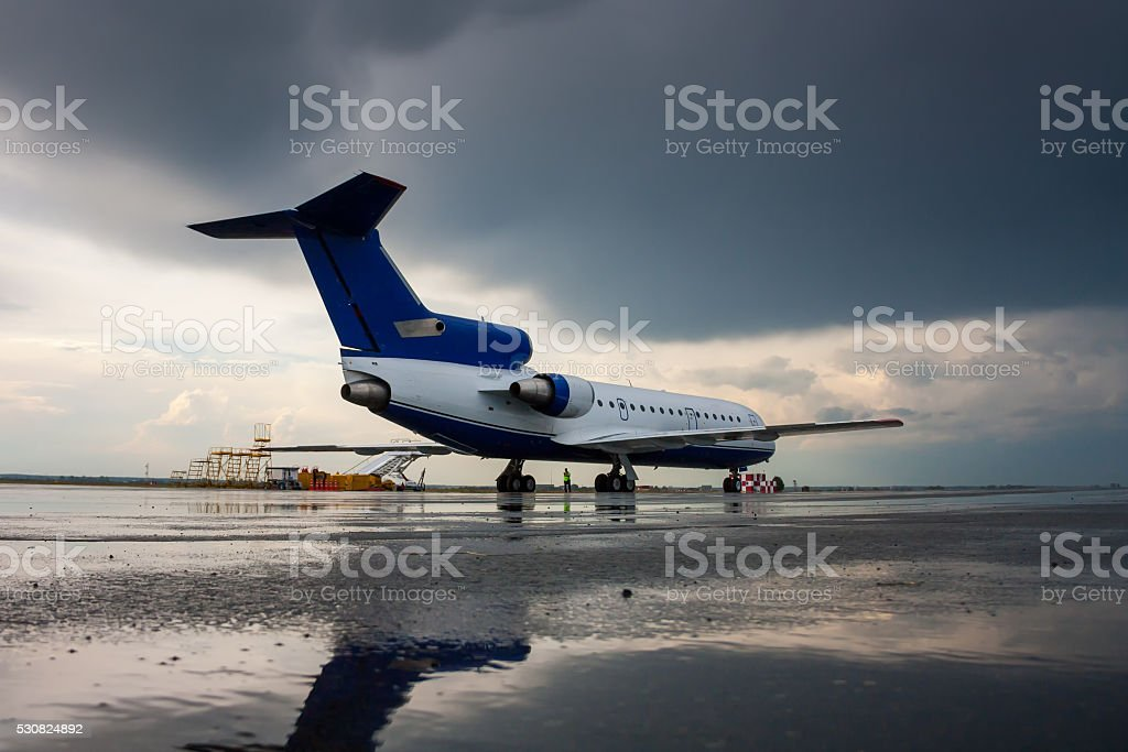 Airplane on the airport apron after the rain royalty-free stock photo