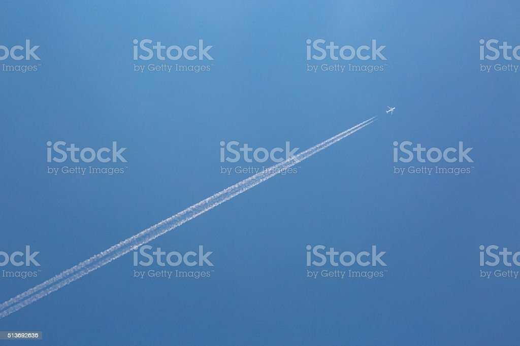 Airplane on the blue sky stock photo