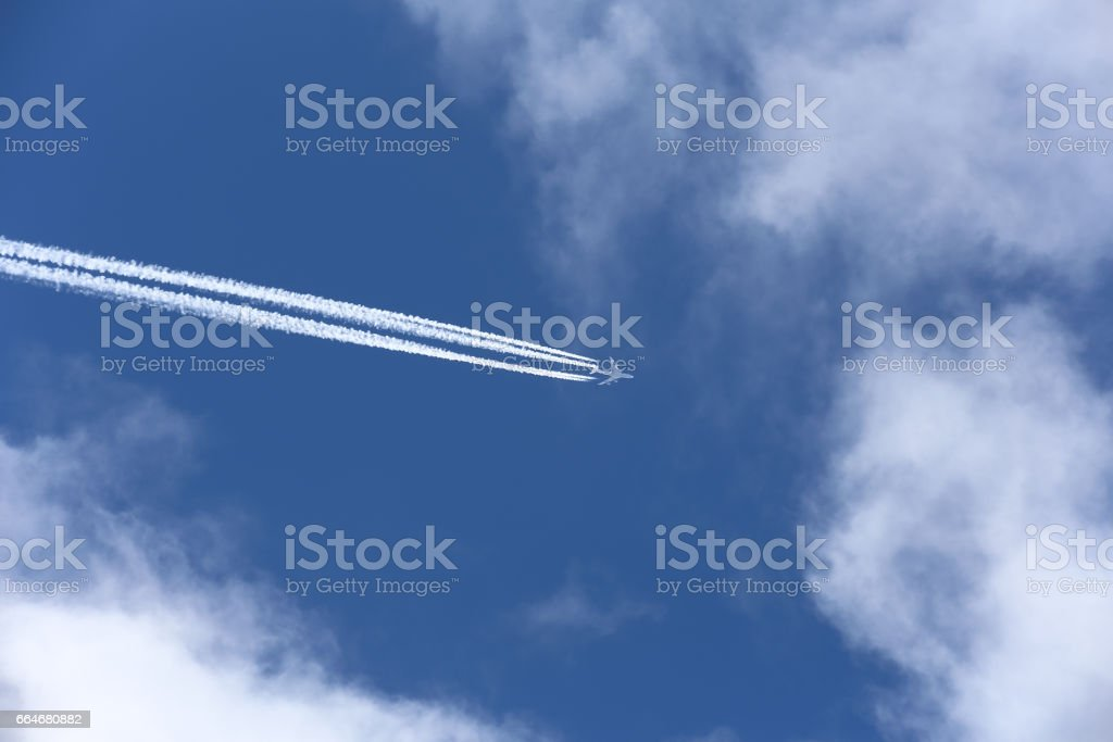 airplane on the cloudy sky stock photo