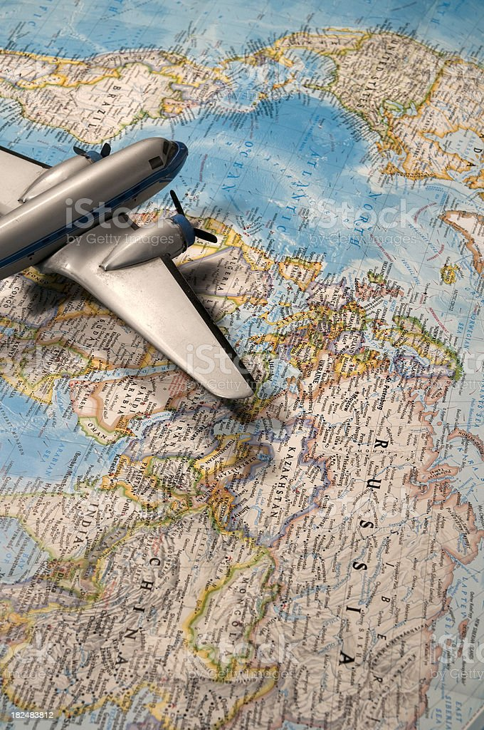 Airplane on World Map royalty-free stock photo