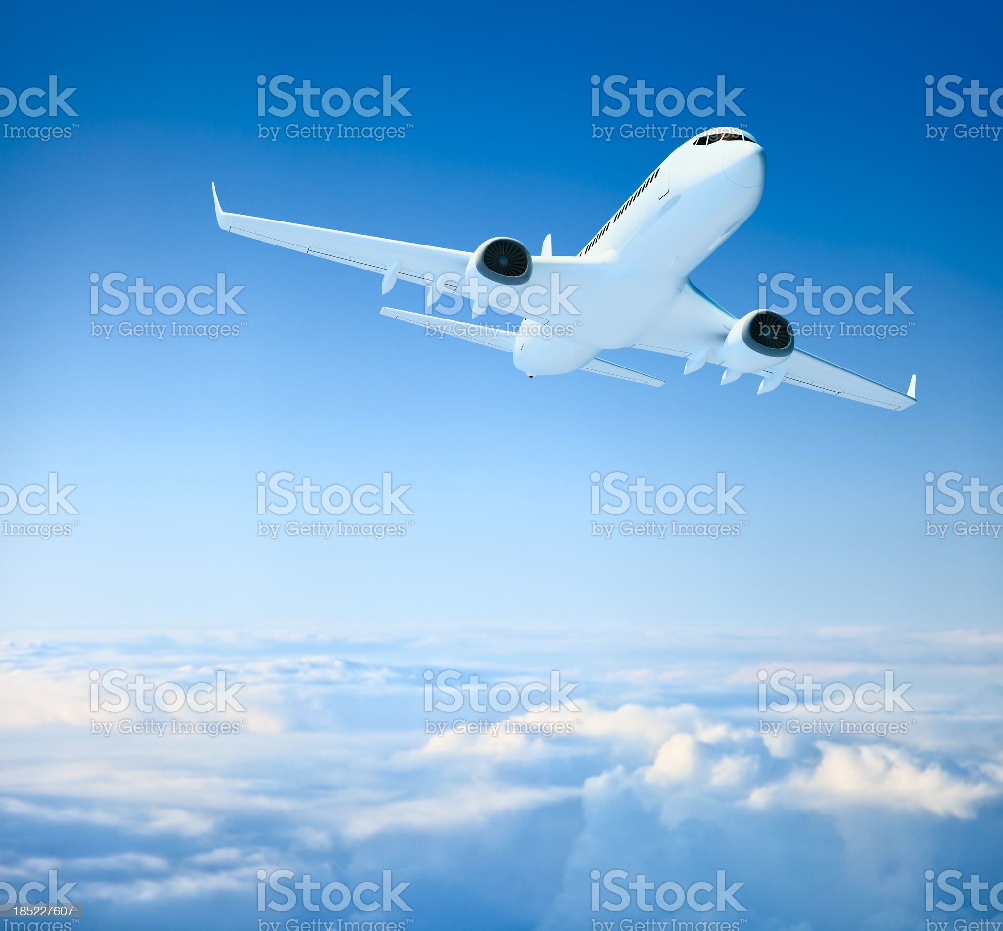 Airplane over clouds royalty-free stock photo