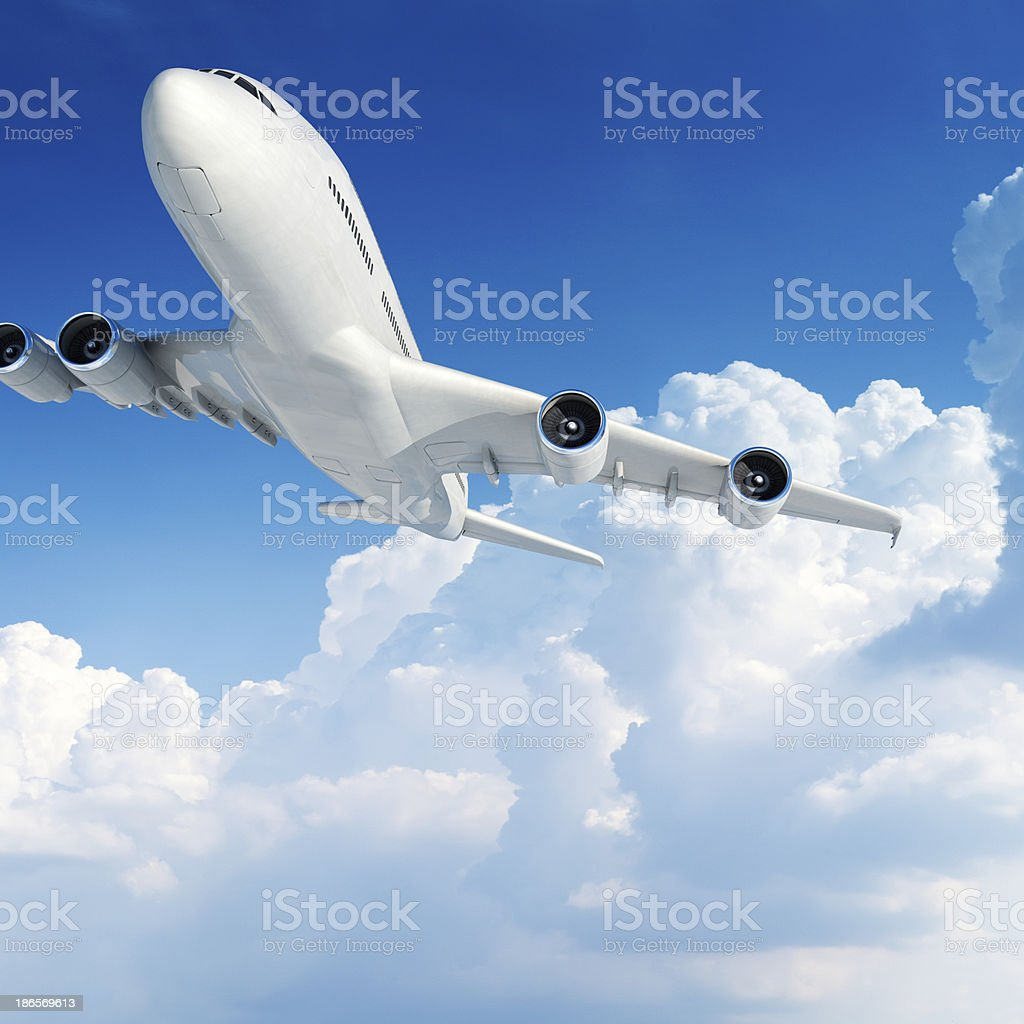 Airplane over clouds stock photo