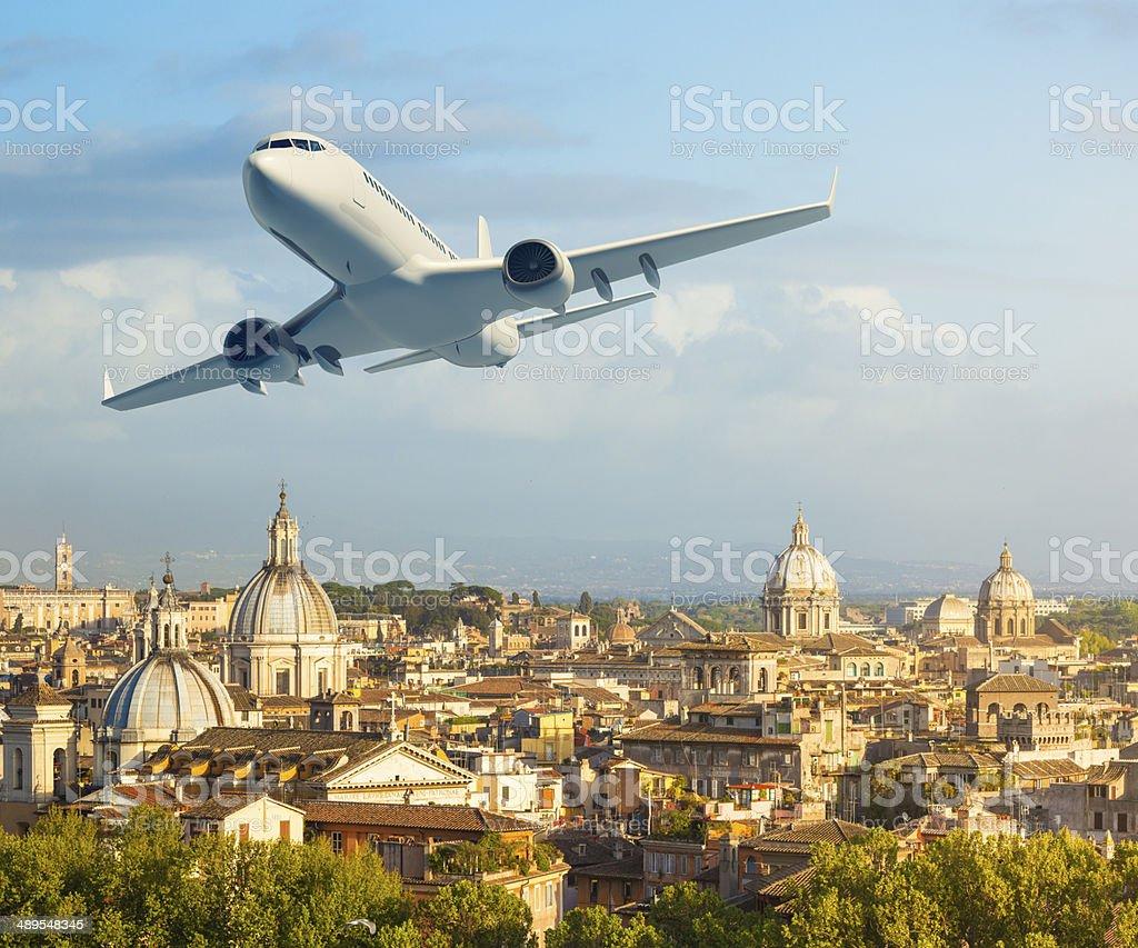 Airplane over Rome stock photo