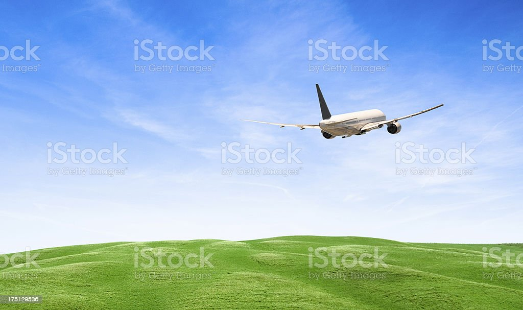 Airplane over the hills royalty-free stock photo