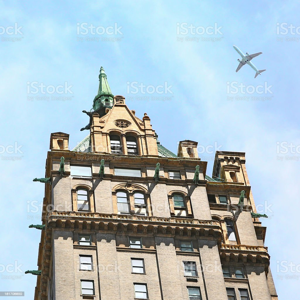 Airplane overflying a building of New York stock photo