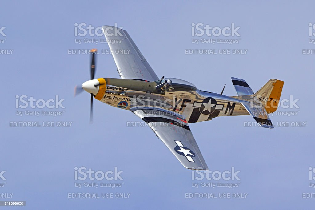 Airplane P-51 Mustang flying at air show stock photo