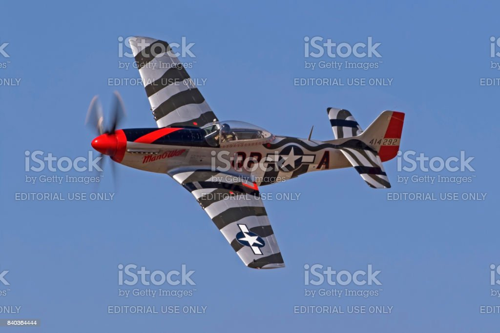 Airplane P-51 Mustang WWII fighter flying at the airshow stock photo