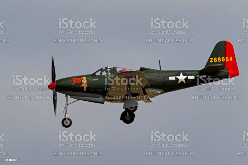 Airplane P-63 King Cobra WWII fighter aircraft landing at the airshow stock photo