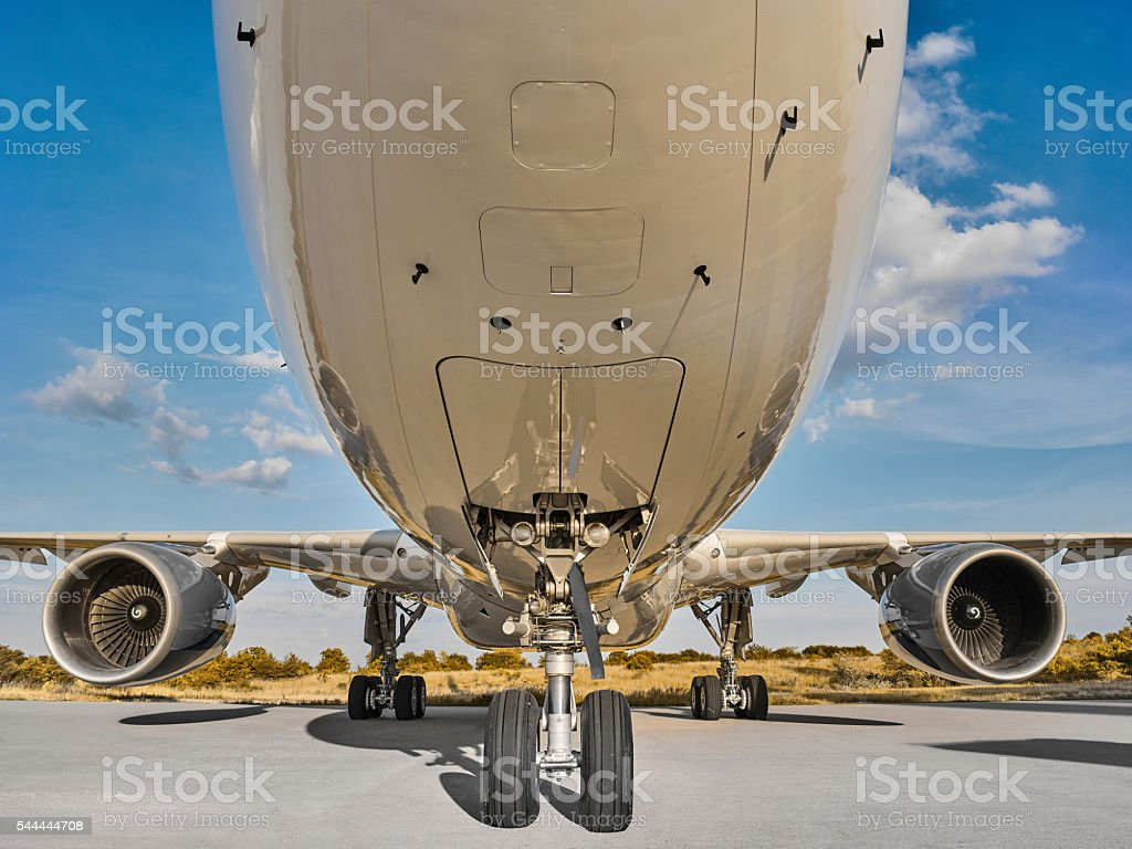 Airplane parked at the airport stock photo