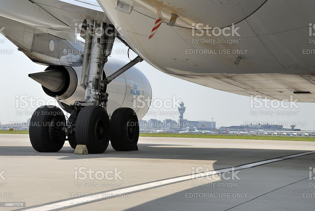 airplane parked on tarmac at Amsterdam Airport Schiphol royalty-free stock photo