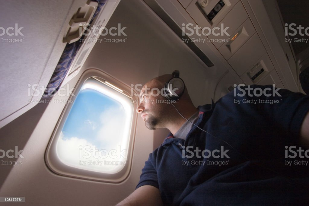 Airplane Passenger Looking Out Window stock photo
