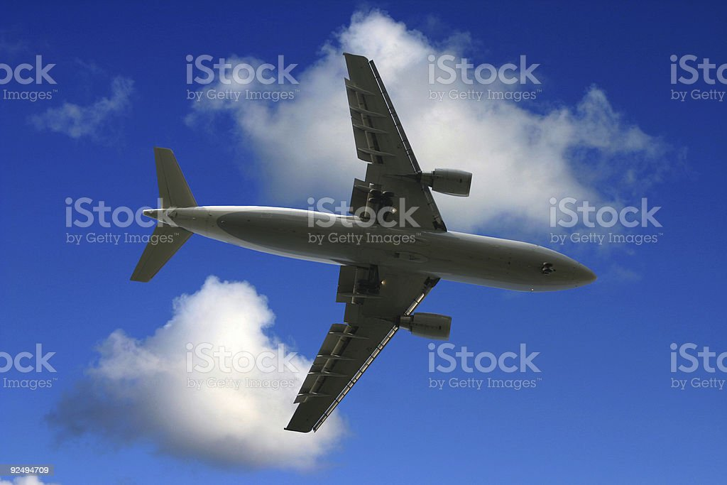 Airplane passing by royalty-free stock photo