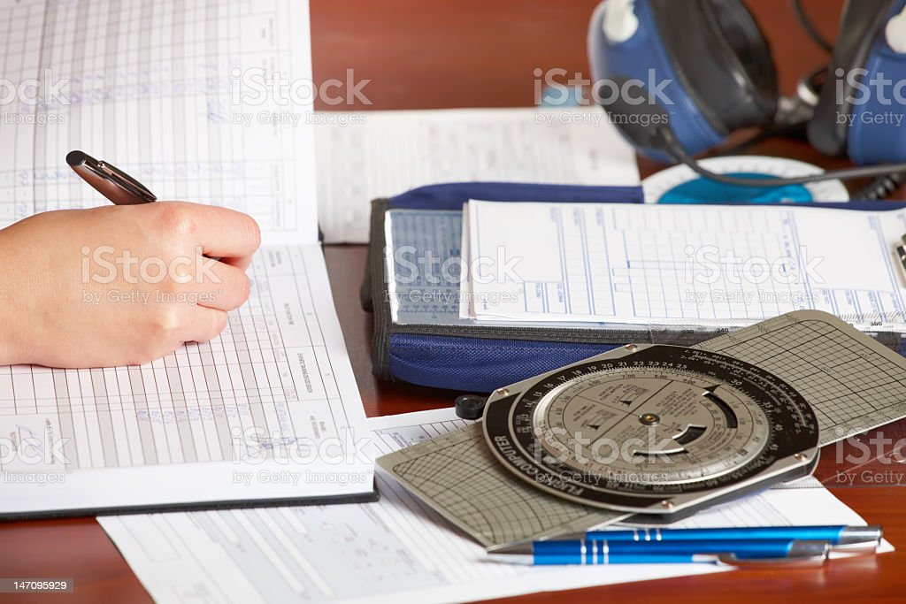 Airplane pilot filling in logbook stock photo