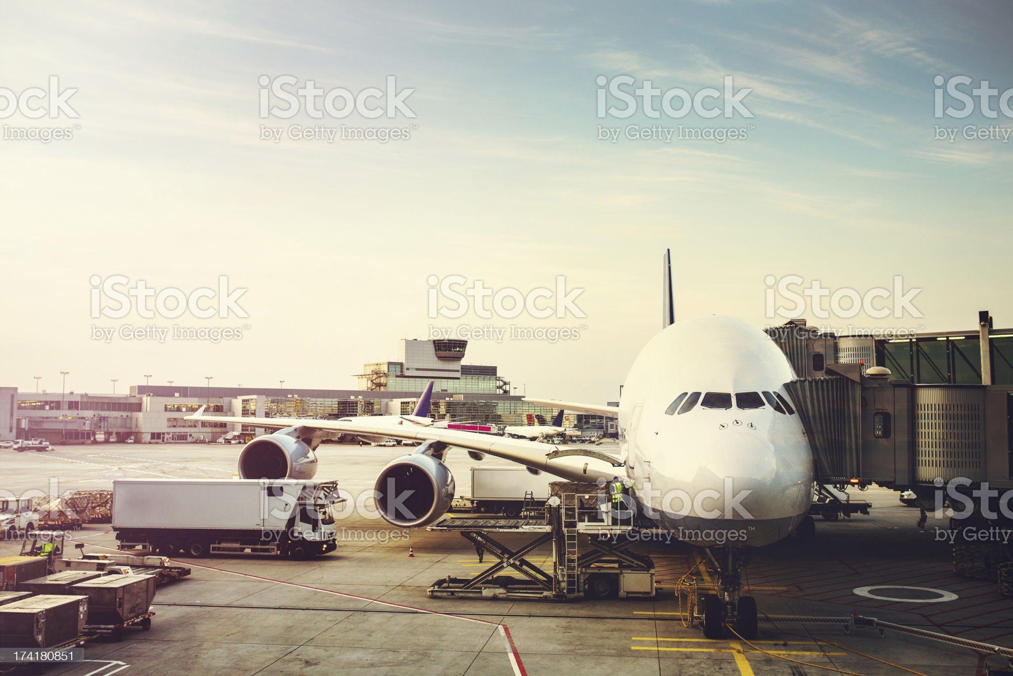 Airplane Preparing to Load on Tarmac royalty-free stock photo