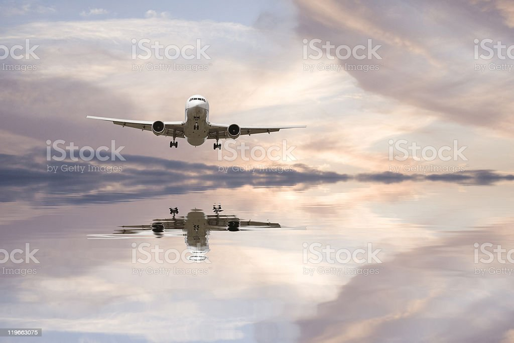 Airplane reflection in water royalty-free stock photo