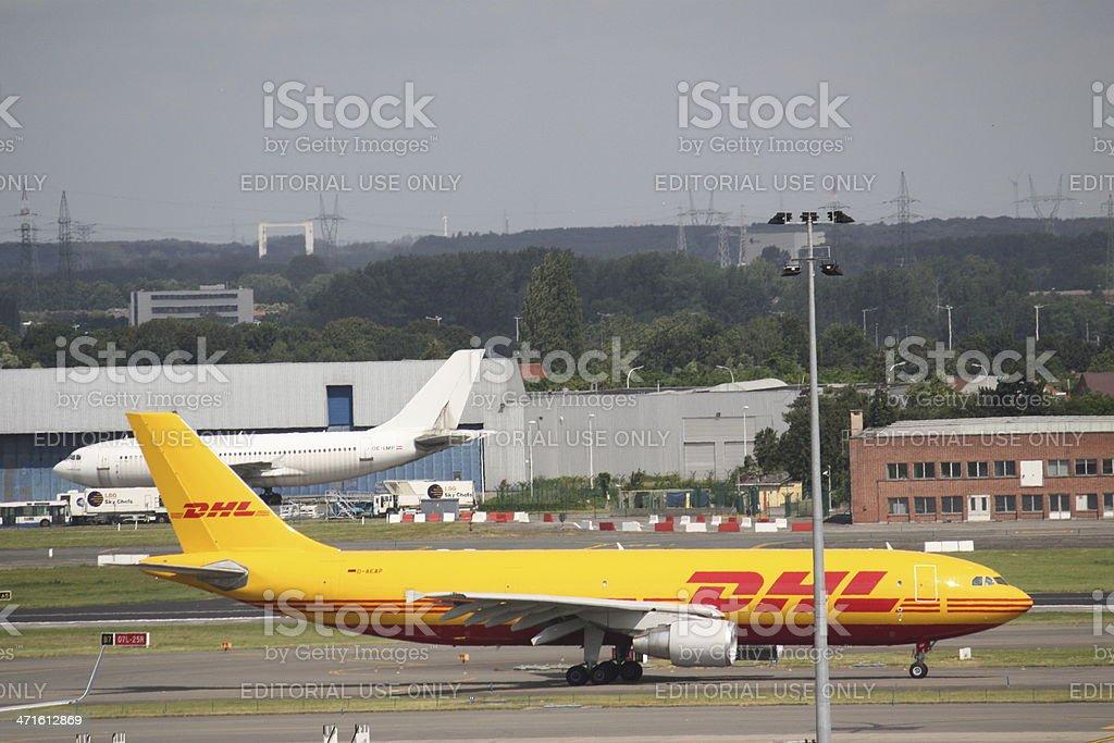 DHL airplane routine flight royalty-free stock photo