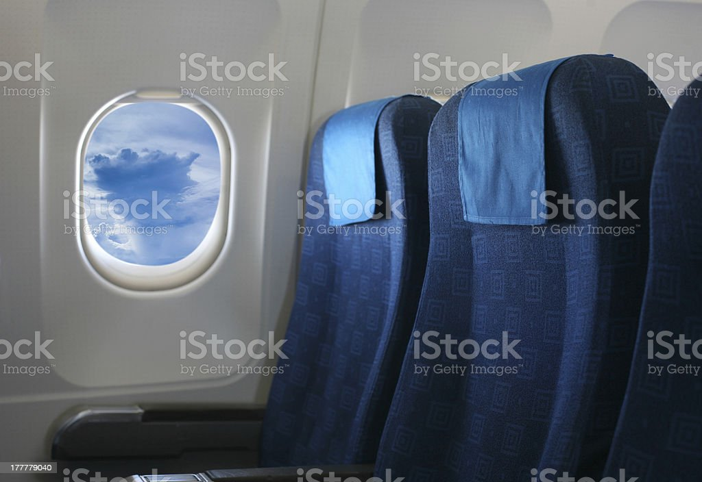 airplane seat and window royalty-free stock photo