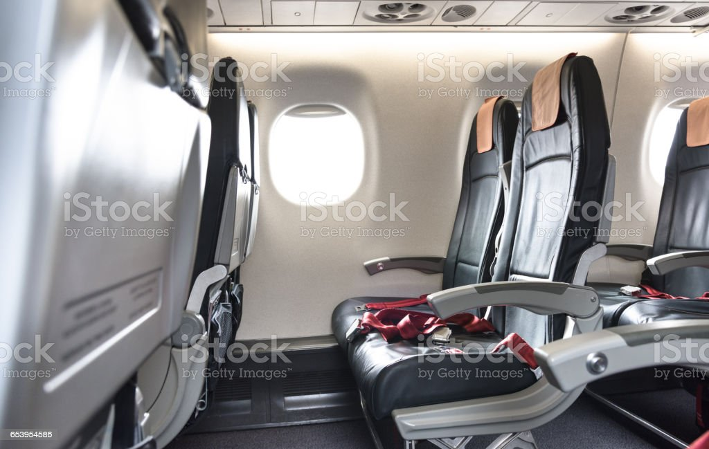 airplane seat in the airplane stock photo