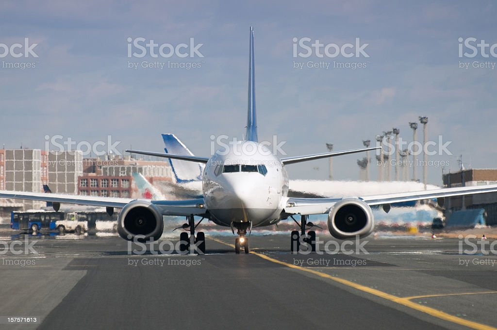 Airplane shortly before take-off, front view, runway, copy space stock photo