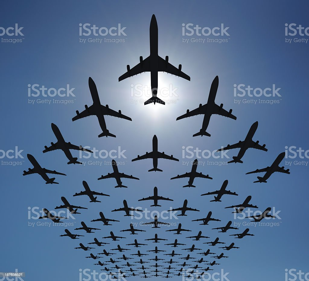 Airplane silhouettes fly in v formation stock photo
