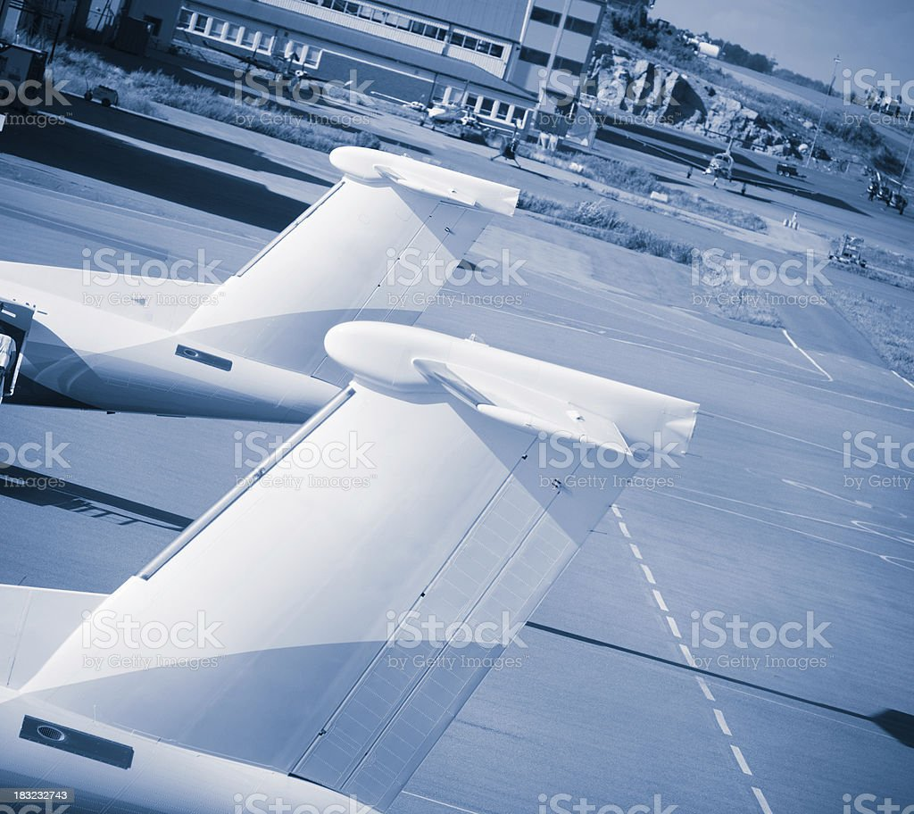 Airplane tail before the take-off - Blue Toned stock photo