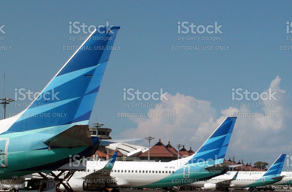 Airplane Tail From Garuda Indonesia Airline Parked At Loading Gate.Jakarta.Airport.Indonesia stock photo
