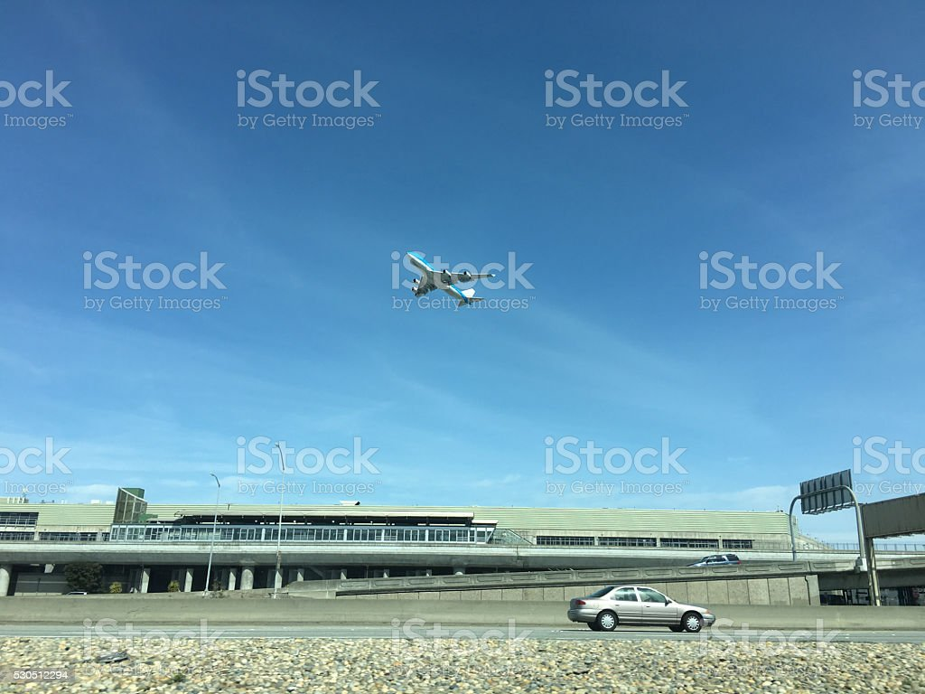 Airplane Take Off Car driving Higway San Francisco Airport stock photo