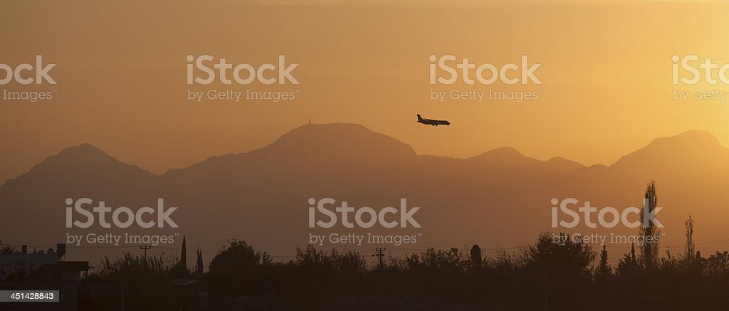 Airplane take off in sunset royalty-free stock photo