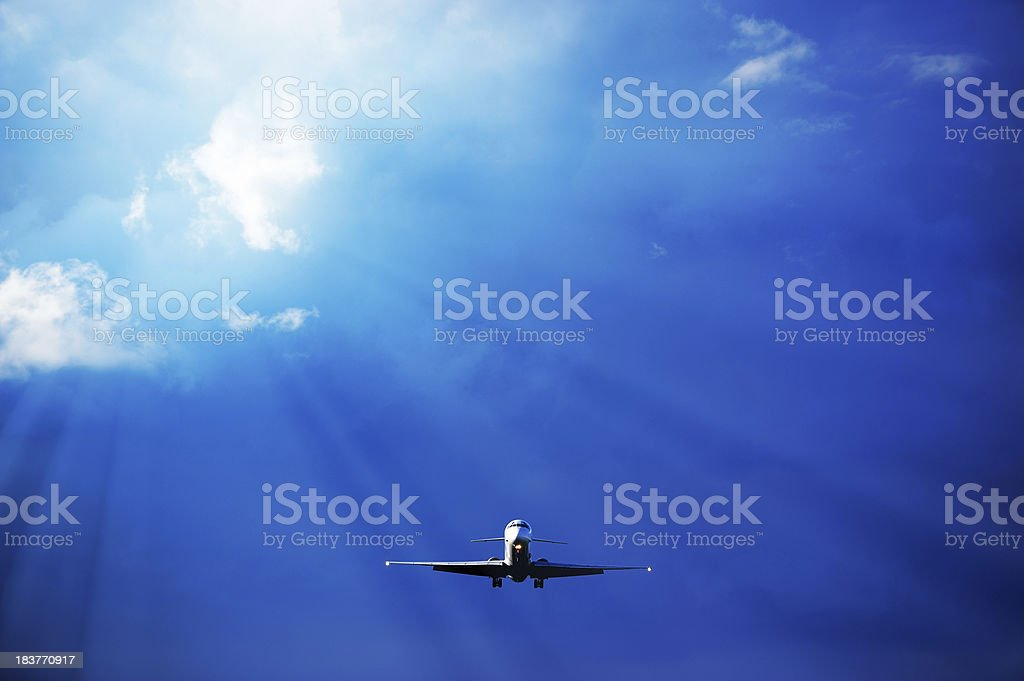 Airplane taking off against dramatic sky royalty-free stock photo