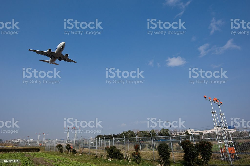 Airplane taking off from runway stock photo