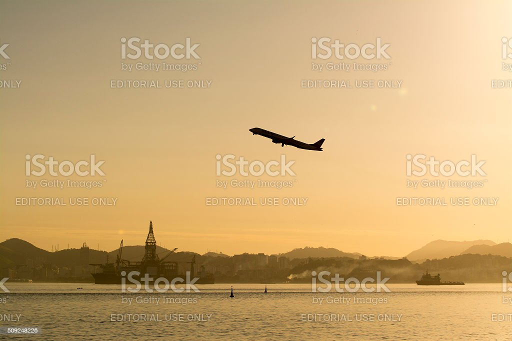 Airplane taking off from SDU stock photo