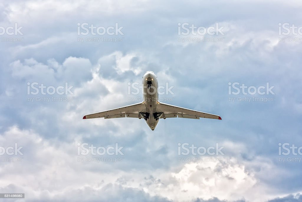Airplane taking off in a somber sky royalty-free stock photo
