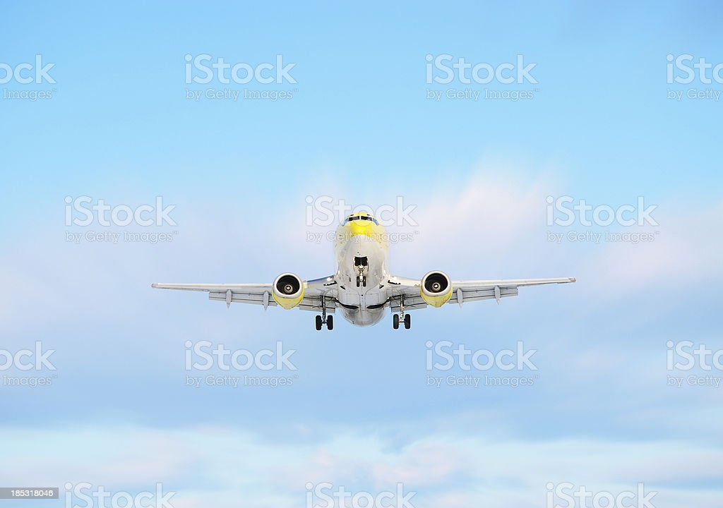 Airplane taking off or lands against bright sky royalty-free stock photo