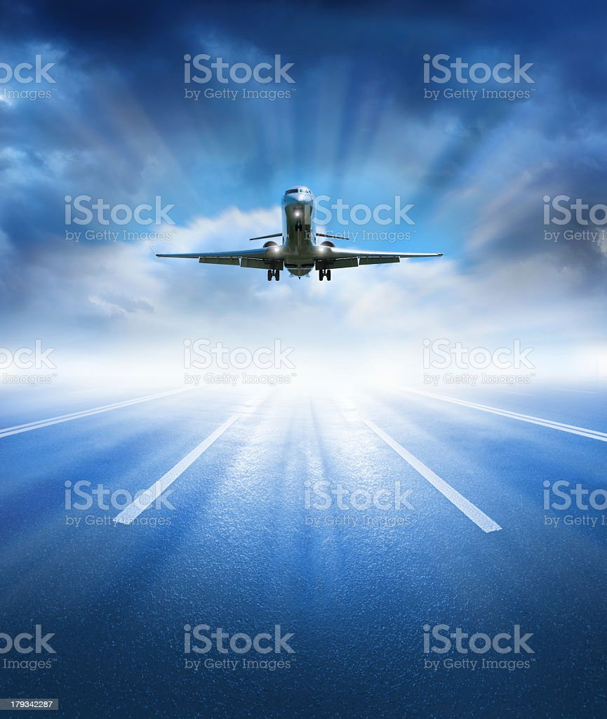 Airplane taking off or lands against dramatic sky stock photo