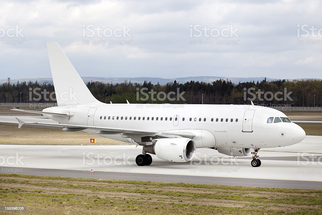 Airplane taxiing on the runway stock photo