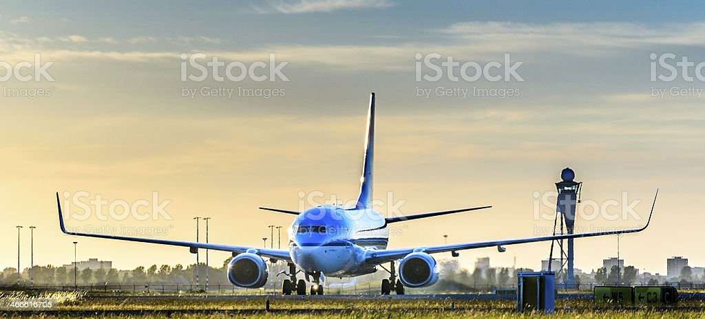 Airplane taxiing runway after landing stock photo