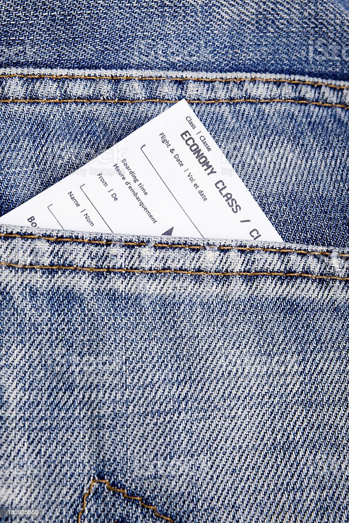 Airplane ticket in jeans pocket royalty-free stock photo