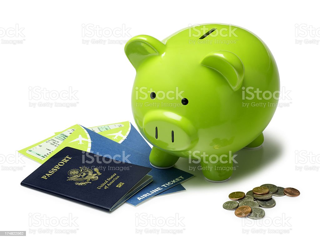 Airplane Tickets and Green Piggy Bank royalty-free stock photo