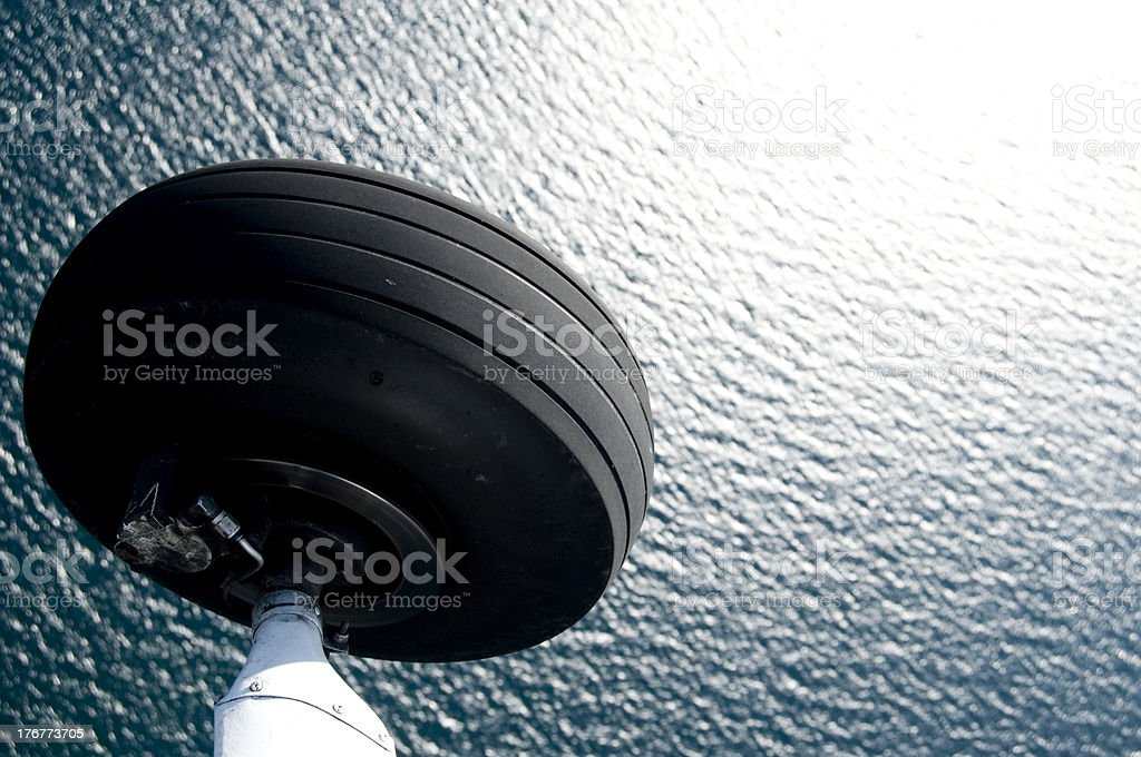 Airplane Tire Over Lakewater stock photo