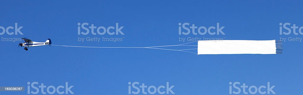 Airplane towing a blank banner stock photo