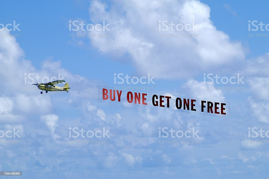 Airplane Towing Banner stock photo