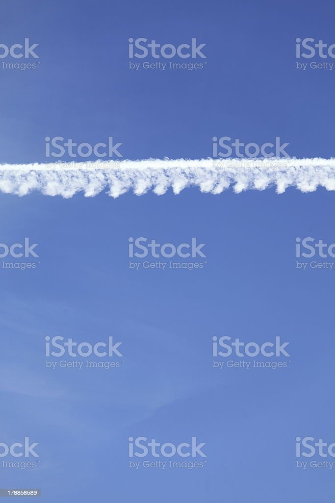 Airplane tracks in the blue sky royalty-free stock photo