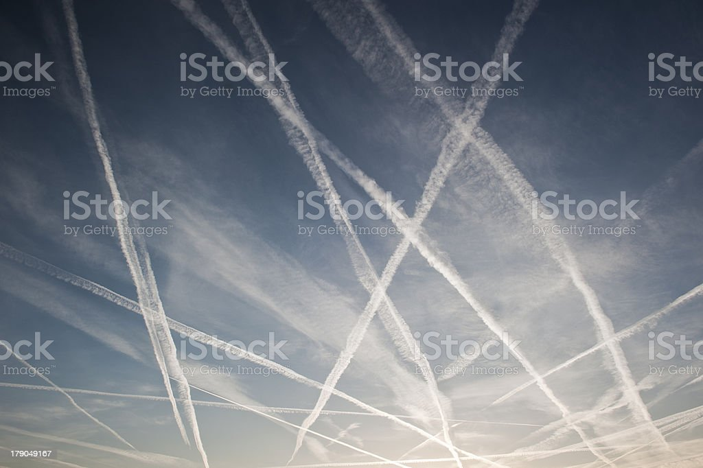 Airplane trails of condesed air in the sky stock photo