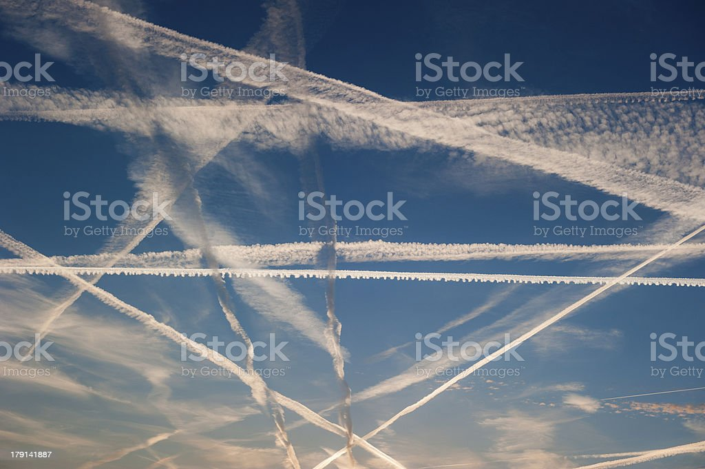 Airplane trails of condesed air in the sky royalty-free stock photo